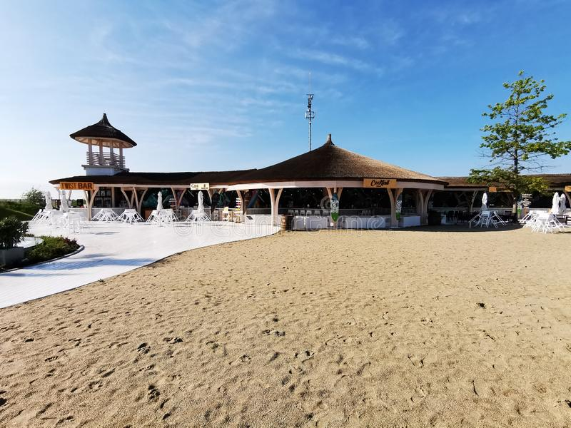 Pool bar on the beach at Therme Bucharest. Pool bar beach  therme bucharest resort romania sand  architectural alley thermal water tree relax hydromassage royalty free stock photos