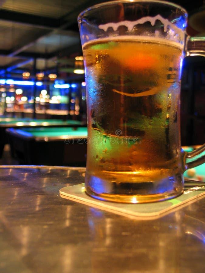 Pool Bar and Beer. At a pool bar having beer stock images