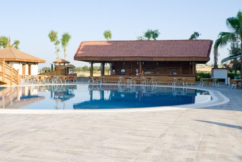 Pool bar at resort. Pool bar with tables and chairs at resort stock photo
