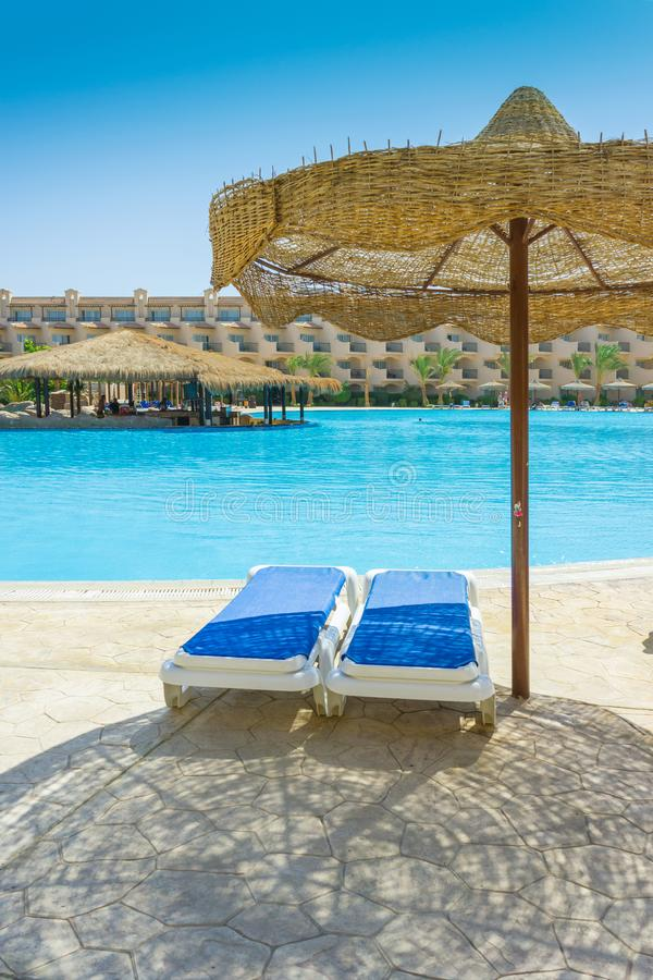 The pool, beach umbrellas and the Red Sea in Egypt royalty free stock photo