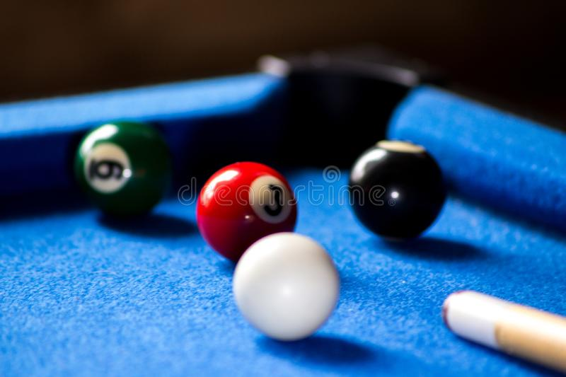 Pool billiard balls on blue table sport game set. Snooker, pool game royalty free stock photography