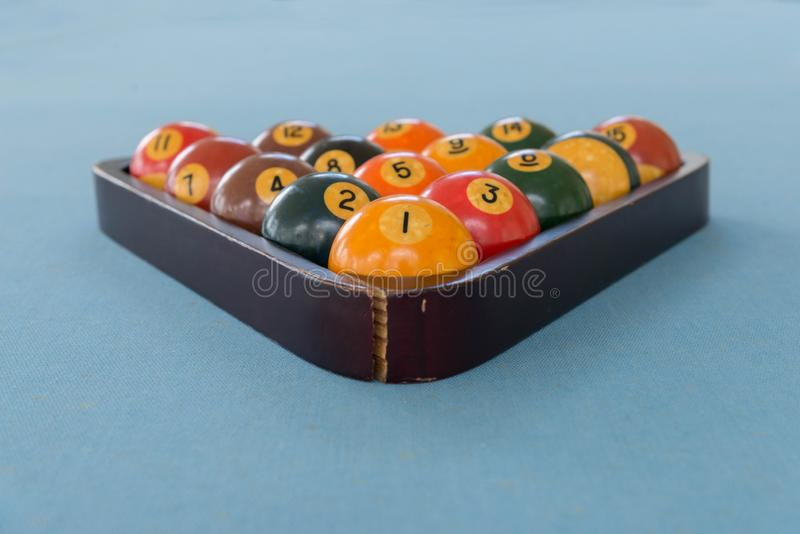 Pool billiards snooker balls on pale blue table royalty free stock image