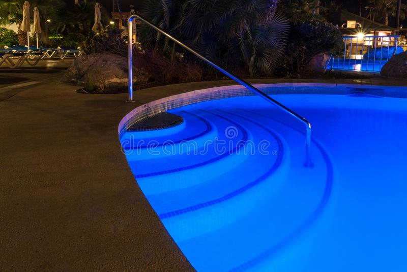 Pool blue shining in the night. Relaxing pool blue shining in the night stock photography