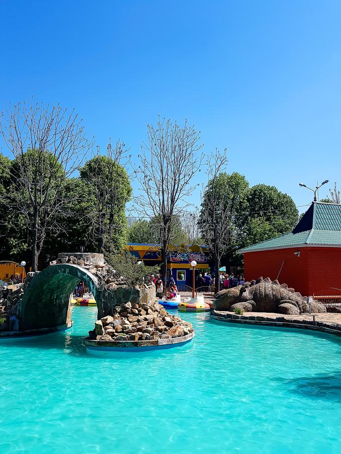Pool with blue water and water machines as attractions in the city amusement park. In city Kirovograd Kropyvnytskyi Ukraine stock photo