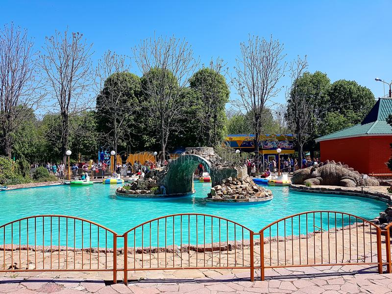 Pool with blue water and water machines as attractions in the city amusement park. In city Kirovograd Kropyvnytskyi Ukraine royalty free stock image