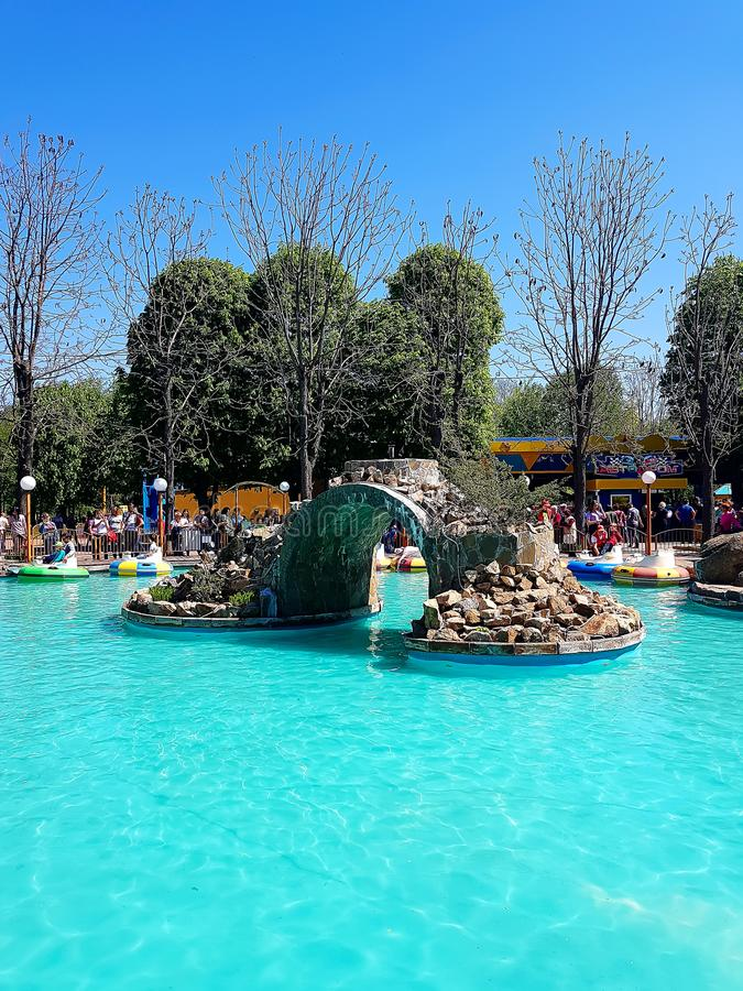Pool with blue water and water machines as attractions in the city amusement park. In city Kirovograd Kropyvnytskyi Ukraine stock image