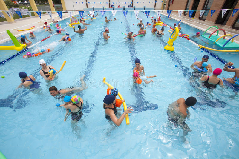 Pool with children and parents in the water playing. Family fun royalty free stock photography