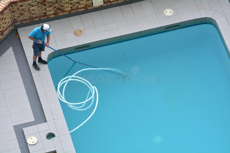 Pool Cleaner Cleaning a Pool royalty free stock image
