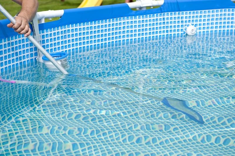 Pool cleaning stock images