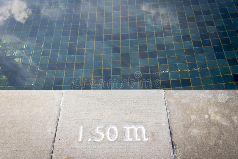 Pool depth sign. At the edge of the swimming pool stock images