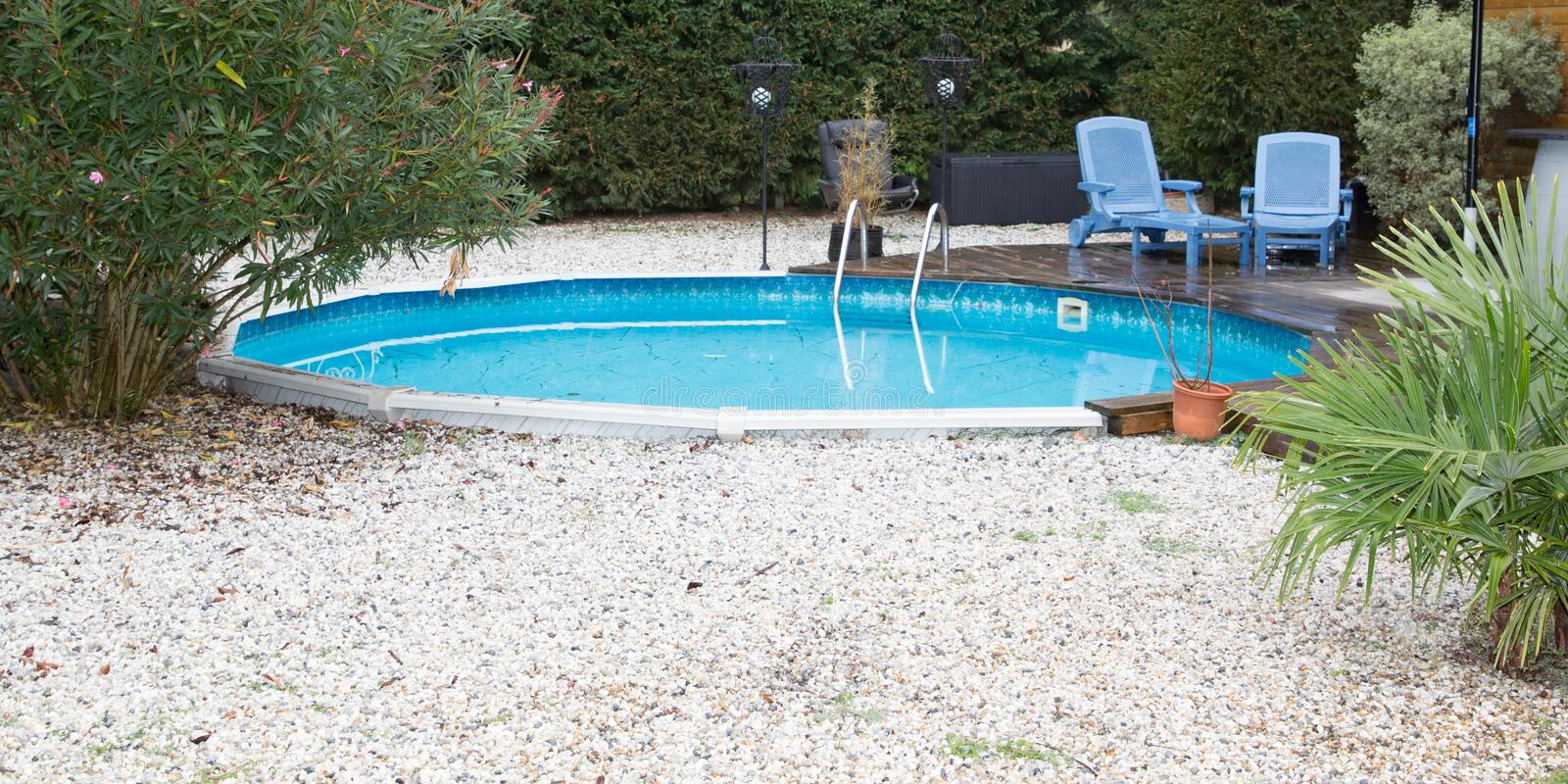 Small round swimming pool in home garden. Pool in home garden at home royalty free stock photography