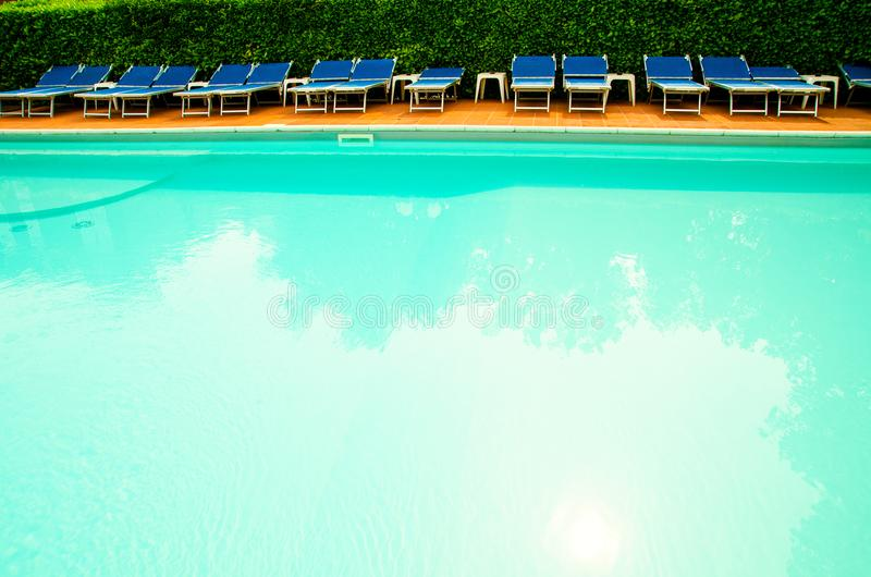 Pool in hotel. Pool with chaise-longues in hotel royalty free stock photography
