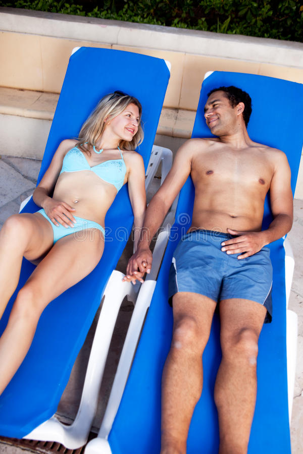 Pool Lounge Chair Couple royalty free stock images