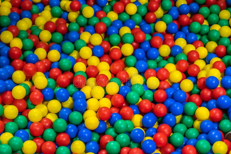 Pool with many colored balls in the kids playing room royalty free stock photography