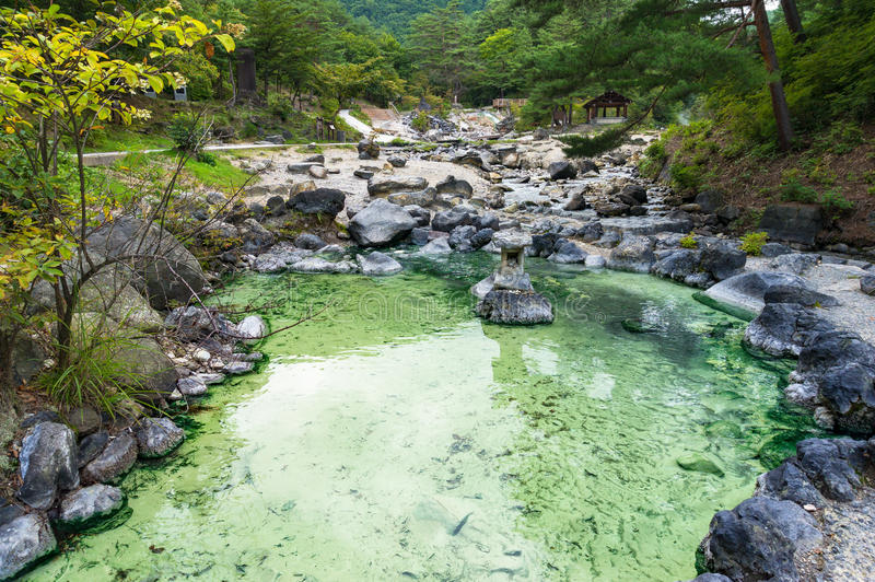 Pool with mineral hot spring water in Kusatsu park in Japan. Pool with mineral hot spring water in public park in Kusatsu, Japan royalty free stock photography
