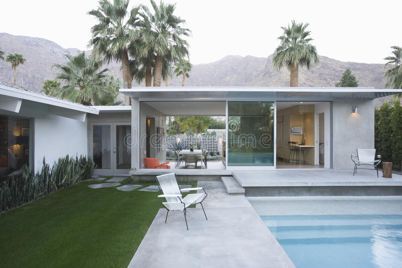 Pool And Modern Home Exterior stock photos