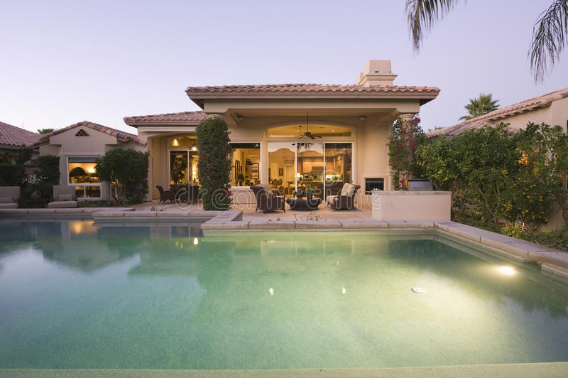 Pool And Modern House Exterior royalty free stock photography
