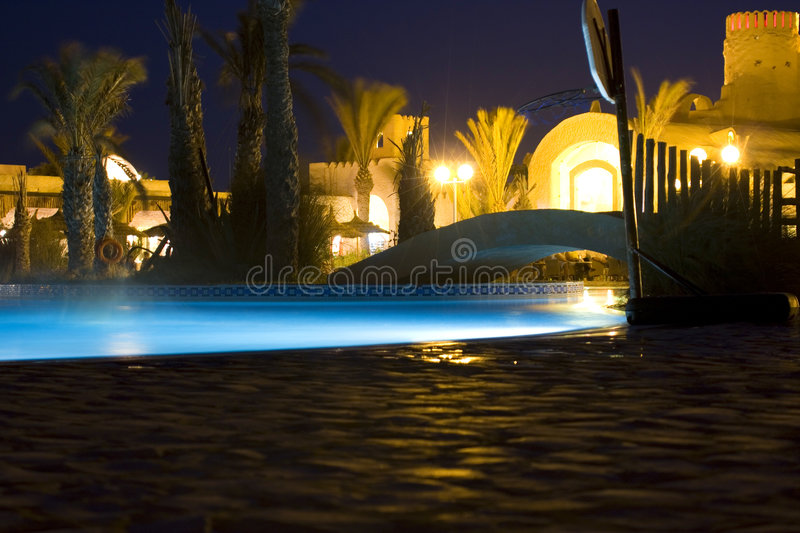 Pool by night royalty free stock photo