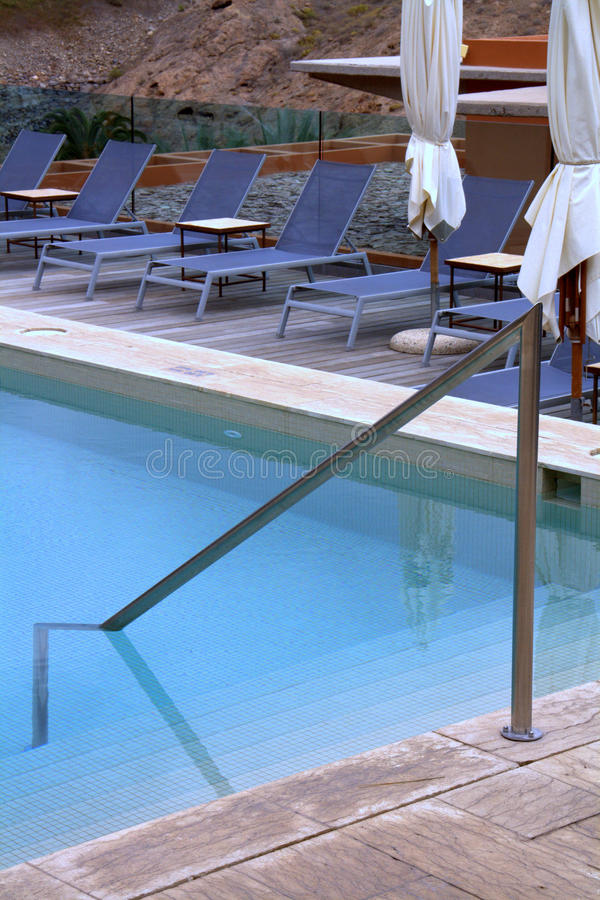 Pool patio lounge chairs stock photography