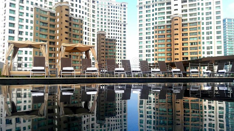 A pool reflecting the building behind royalty free stock photography