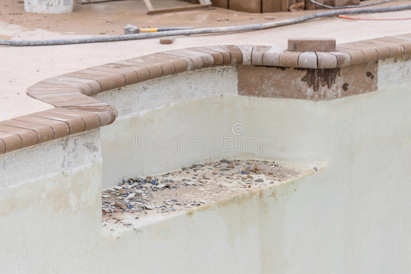 Pool repairs to seat niche. Pool repair work and new brick coping stock photos