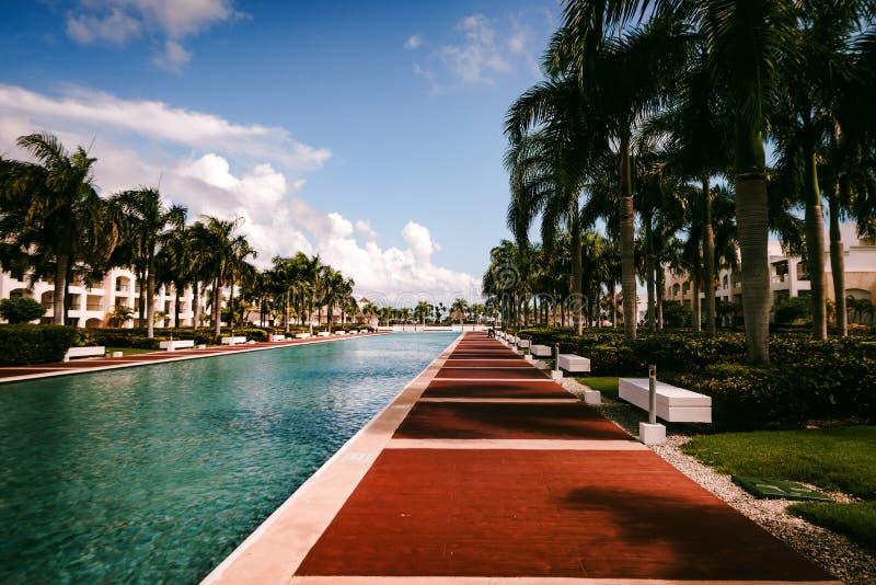 Luxury tropical hotel in Dominican Republic. Pool in the resort and spa luxury tropical hotel in Punta Cana, Dominican Republic stock photo