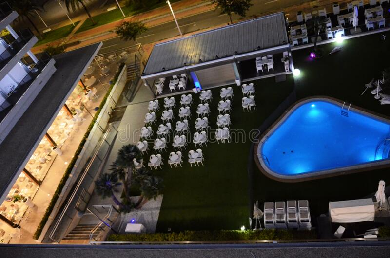 Pool and restaurant of an hotel at night royalty free stock photos