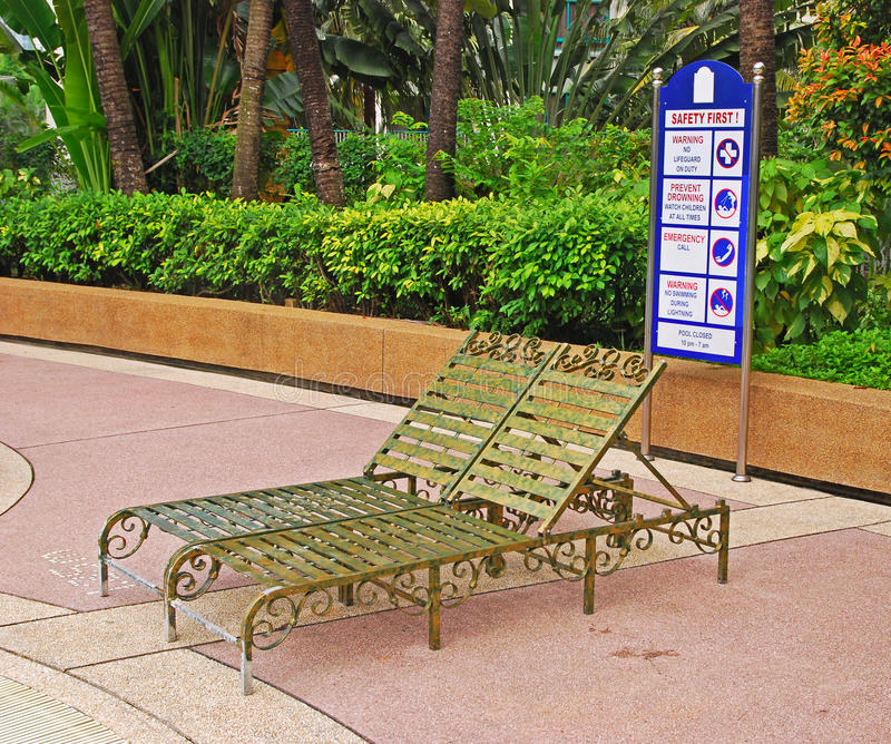 Pool Side Deckchair With Safety First Instruction Board
