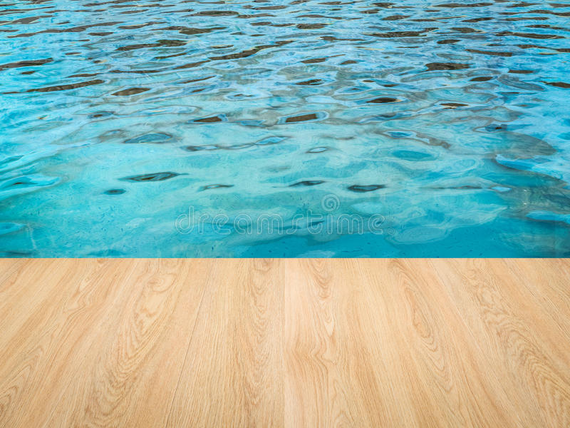 Pool side with wooden floor stock images
