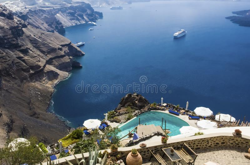 View in Caldera of Santorini from pool of small hotel, Greece stock images