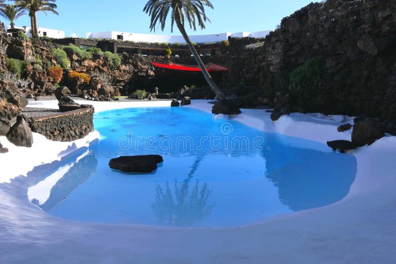 Los Jameos de Agua, Lanzarote. A pool with soils and rocks painted white for color shocks with lava was built by Manrique stock images