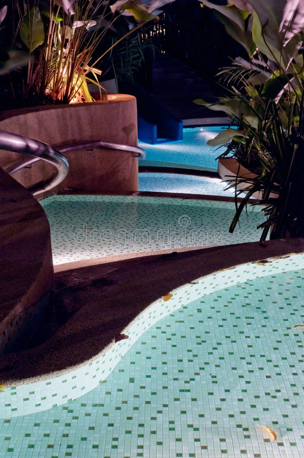 Pool steps in a resort royalty free stock photo