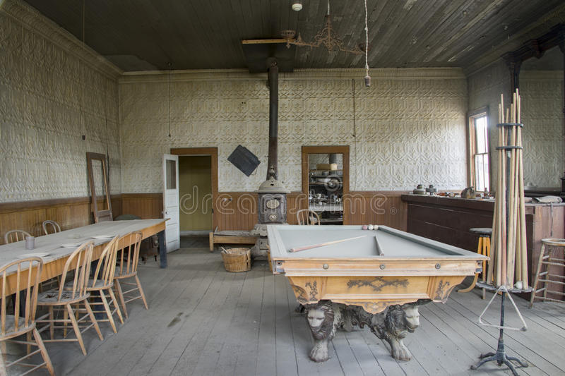 Pool table and bar, Wheaton and Hollis Hotel, Bodie, California. Interior of Wheaton and Hollis Hotel with pool table, dining table and saloon bar in Bodie State royalty free stock image