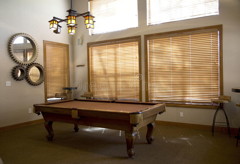 Pool table in the game room stock photos