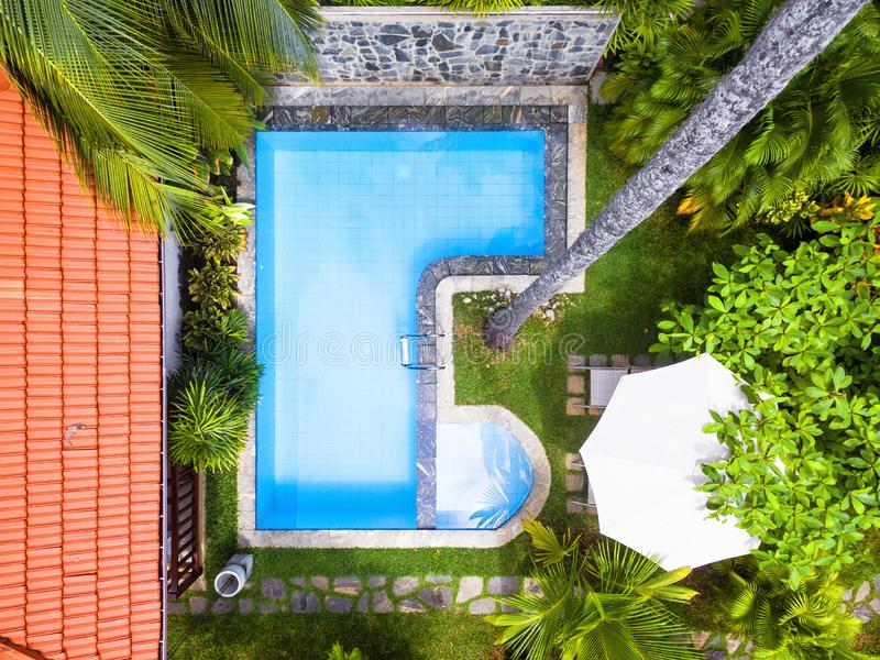 Pool in tropical hotel or residential house stock photos