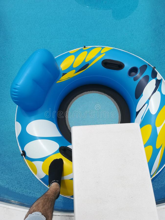 Pool tube and diving board royalty free stock photo
