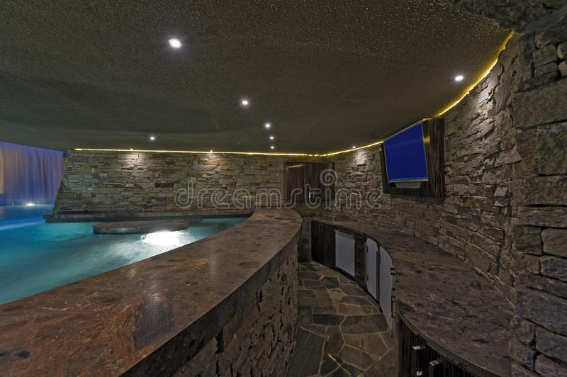 Pool With Tv On Stone Wall Royalty Free Stock Images