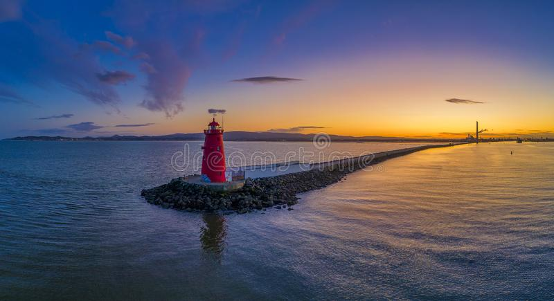 The Poolbeg Lighthouse - Dublin at sunset, Poolbeg Lighthouse in Dublin Bay stock photo
