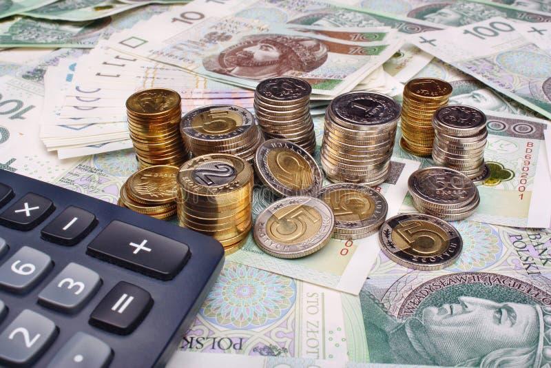 Poolse geld en calculator stock afbeeldingen