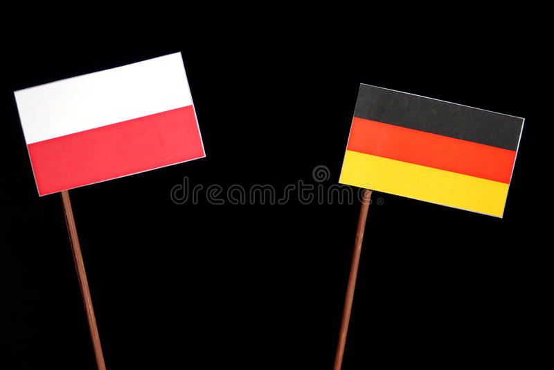 Poolse vlag met Duitse vlag op zwarte royalty-vrije stock fotografie