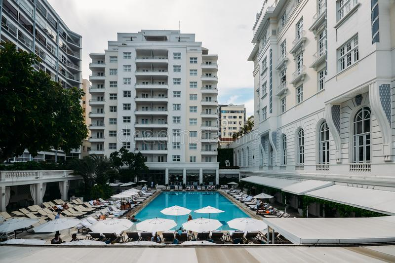 Poolside bar and lounge chairs at luxurious Copacabana Palace Belmond in Copacabana, Rio de Janeiro, Brazil. Rio de Janeiro, Brazil, March 17, 2019: Poolside bar royalty free stock photography