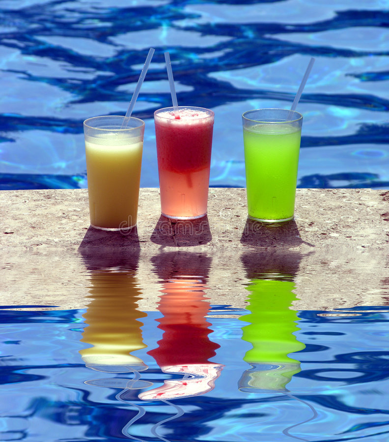 Poolside Beverages. Delicious and colorful poolside beverages royalty free stock photo