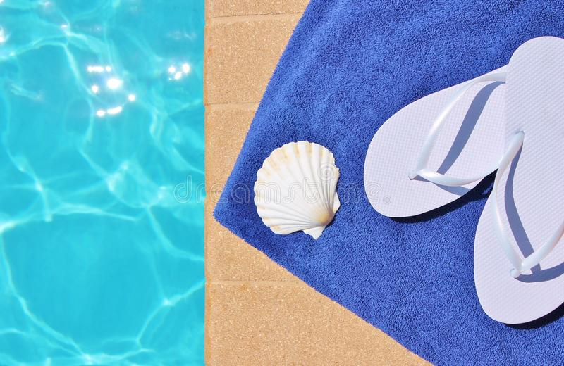 Poolside holiday scenic shell towel thongs swimming pool stock images