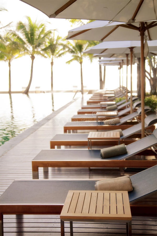 Download Poolside loungers stock image. Image of bright, lifestyle - 20552597