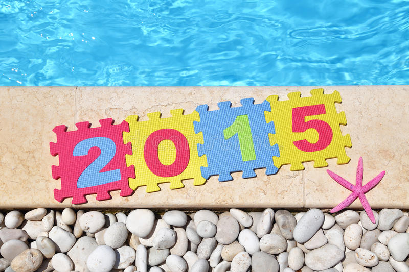 2015 by poolside. Made with jigsaw puzzle pieces stock photo
