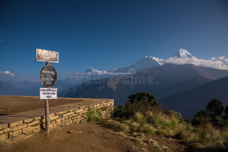Poon hill altitude sign with Annapurna range in background, Nepal. royalty free stock image