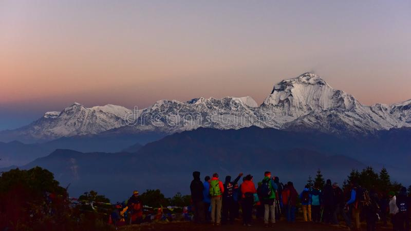 Tourists admiring Dhaulagiri mountain ranges at dawn from Poon Hill royalty free stock photography