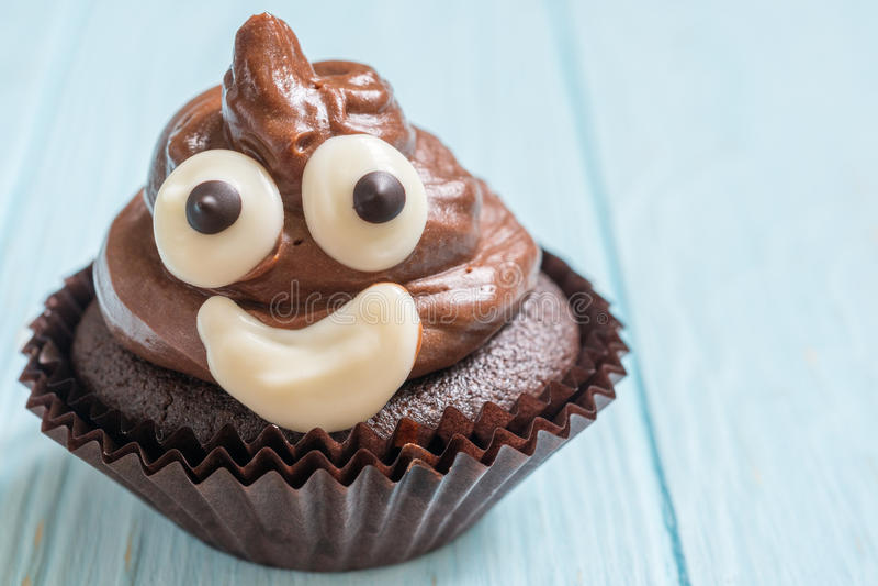 Poop emoji cupcakes. Funny poop emoji chocolate cupcakes. Cute food dessert stock photo
