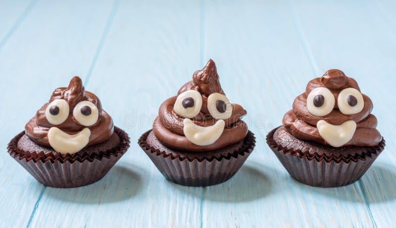 Poop emoji cupcakes. Funny poop emoji chocolate cupcakes. Cute food dessert stock images