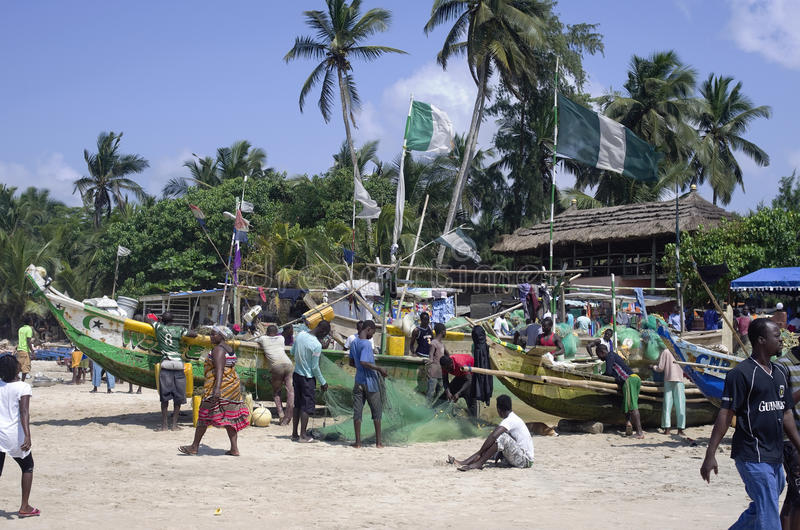 Poor African fish market. ACCARA, GHANA - AUGUST 10, 2014: Fishing boats and market of souvenirs in the sea coast of the poor African country. In 1957, Ghana stock image